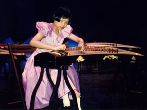 Photo: Fiona Sze, age 11, performing on the zheng